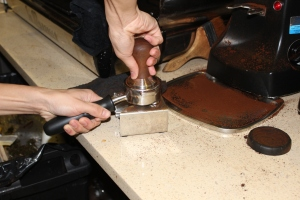 """Coffee grounds are subsequently packed tightly, in a process known as """"tamping,"""" into the portafilter in order to allow water to even distribute throughout the grounds during the brewing process."""
